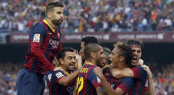 """Barcelona's Neymar is congratulated by team mates after scoring a goal against Real Madrid during their Spanish first division """"Clasico"""" soccer match at Nou Camp stadium in Barcelona"""