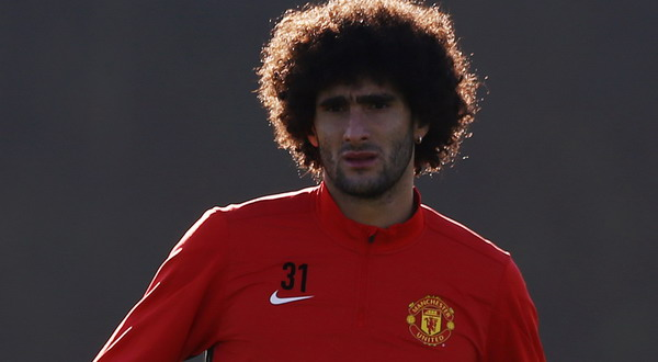 Manchester United's Fellaini pulls up his shorts during a training session in Manchester